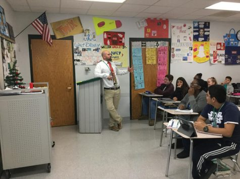 Mr. Pasek teaches his students the ins and outs of accounting.