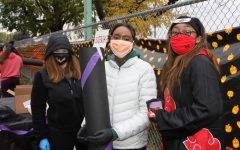 Ms. Hyland, Asia Stevenson, and Maylasia represent Leadership club at the Trick-or-Treating event