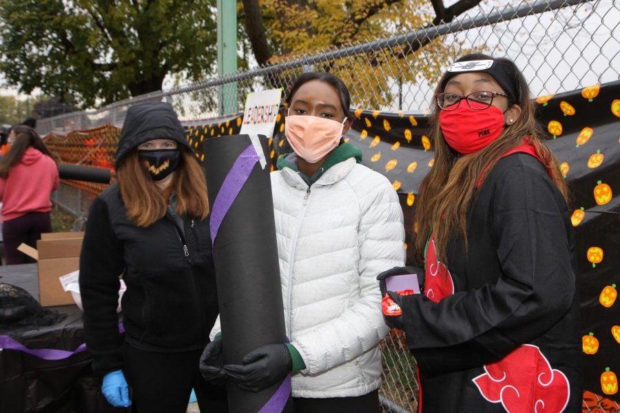 Ms.+Hyland%2C+Asia+Stevenson%2C+and+Maylasia+represent+Leadership+club+at+the+Trick-or-Treating+event